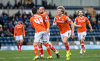 Cameron McGeehan (8) of Luton Town celebrates scoring the winning goal during the Sky Bet League 2 match between Wycombe Wanderers and Luton Town at Adams Park, High Wycombe, England on 6 February 2016. Photo by Andy Rowland.