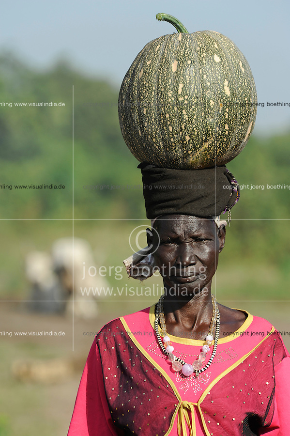 SOUTH SUDAN  Bahr al Ghazal region , Lakes State, town Rumbek , portrait of Dinka woman with pumpkin