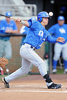 Center Fielder Austin Cousino #19 swings at a pitch during a  game against the Tennessee Volunteers at Lindsey Nelson Stadium on March 24, 2012 in Knoxville, Tennessee. The game was suspended in the bottom of the 5th with the Wildcats leading 5-0. Tony Farlow/Four Seam Images.