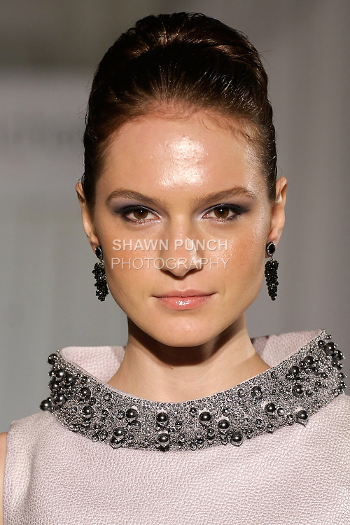 Tania walks runway in a dove gray cobra embossed silk, raffia fabric trapeze with hand embroidered beaded collar from the b Michael AMERICA Couture Spring 2013 collection during Mercedes-Benz Fashion Week Spring 2013, at the Jumeirah Essex House on September 12, 2012.