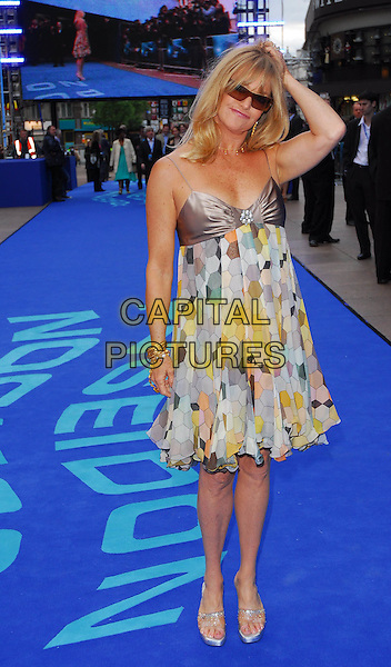 "GOLDIE HAWN .At the UK Film Premiere of ""Poseidon"", .Empire Leicester Square, London, .May 28th 2006..full length sunglasses armpit print patterned babydoll chiffon satin dress arm touching scratching head hair.Ref: CAN.www.capitalpictures.com.sales@capitalpictures.com.©Can Nguyen/Capital Pictures"