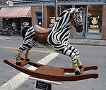 "A view of, ""Stripes & Hooves"" by artist, Madelyn Decker, one of the 35 Artist painted Rocking Horses on display around Saugerties, NY as part of the Chamber of Commerce sponsored Art in the Village Project titled ""Rockin' Around Saugerties."" This photo taken on Friday, May 26, 2017. Photo by Jim Peppler. Copyright/Jim Peppler-2017."