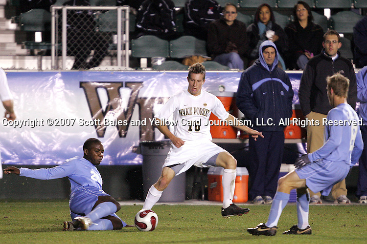 16 November 2007: North Carolina's Andre Sherard (20) tackles the ball away from Wake Forest's Corben Bone (10). Wake Forest University played the University of North Carolinaat SAS Stadium in Cary, NC in an Atlantic Coast Conference Men's Soccer tournament semifinal.