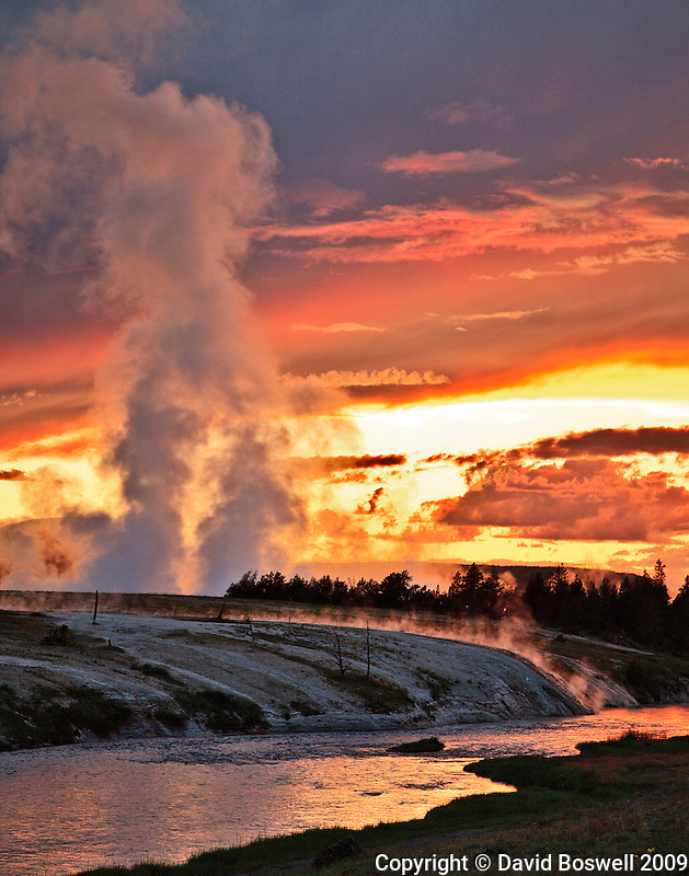 The sun sets on the aptly named Firehole River and Midway Geyser Basin in Yellowstone National Park.
