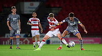 Lincoln City's Ellis Chapman vies for possession with Doncaster Rovers' Kieran Sadlier<br /> <br /> Photographer Chris Vaughan/CameraSport<br /> <br /> EFL Leasing.com Trophy - Northern Section - Group H - Doncaster Rovers v Lincoln City - Tuesday 3rd September 2019 - Keepmoat Stadium - Doncaster<br />  <br /> World Copyright © 2018 CameraSport. All rights reserved. 43 Linden Ave. Countesthorpe. Leicester. England. LE8 5PG - Tel: +44 (0) 116 277 4147 - admin@camerasport.com - www.camerasport.com