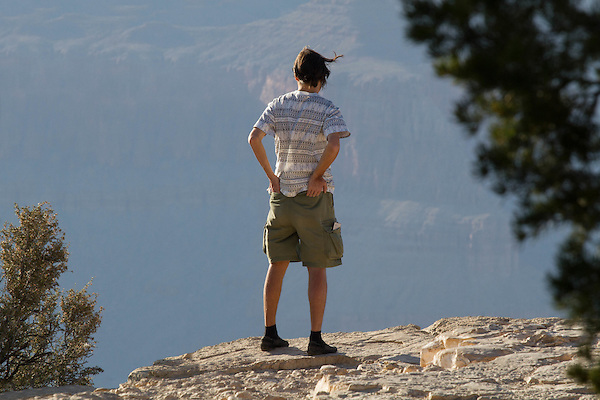 Navajo scout looks over the South Rim of Grand Canyon National Park, Arizona . John offers private photo tours in Grand Canyon National Park and throughout Arizona, Utah and Colorado. Year-round.