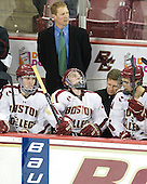 Patrick Wey (BC - 6), Greg Brown (BC - Assistant Coach), Patch Alber (BC - 3), Bert Lenz (BC - Trainer), Isaac MacLeod (BC - 7) - The Boston College Eagles defeated the Merrimack College Warriors 4-2 to give Head Coach Jerry York his 900th collegiate win on Friday, February 17, 2012, at Kelley Rink at Conte Forum in Chestnut Hill, Massachusetts.