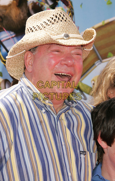"WILLIAM SHATNER.""Over The Hedge"" Los Angeles Premiere held at the Mann Village Theater, Westwood, California, USA..April 30th, 2006.Photo: Russ Elliot/AdMedia/Capital Pictures.Ref: RE/ADM.headshot portrait mouth open straw hat.www.capitalpictures.com.sales@capitalpictures.com.© Capital Pictures."