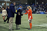 21 November 2014: Colorado's Kate Scheele (1) is greeted by UNC head coach Anson Dorrance (center) and goalkeeper coach Chris Ducar (left) after the game. The University of North Carolina Tar Heels hosted the University of Colorado Buffaloes at Fetzer Field in Chapel Hill, NC in a 2014 NCAA Division I Women's Soccer Tournament Second Round match. UNC won the game 1-0 in overtime.