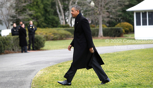 United States President Barack Obama returns to the White House from a Christmas vacation in Hawaii on December 27, 2012..Credit: Dennis Brack / Pool via CNP