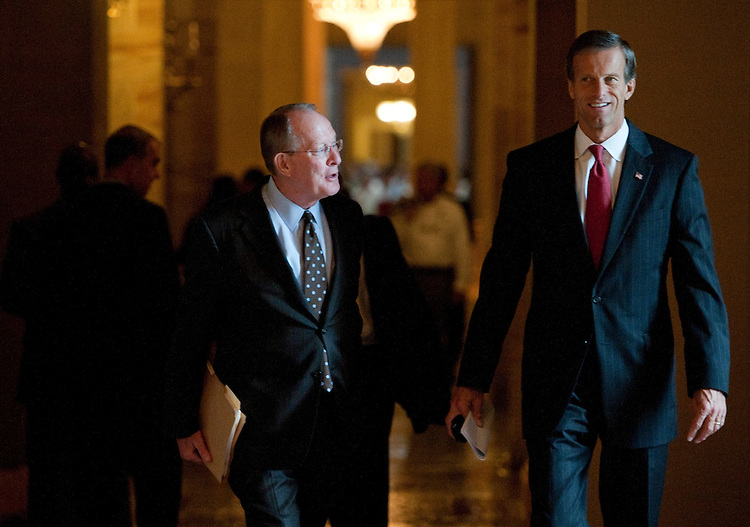 UNITED STATES - JULY 21: Sen. Lamar Alexander, R-Tenn., left, and Sen. John Thune, R-S. Dak., leave a meeting with other Senate Republicans in Minority Leader Mitch McConnell's office on July 21, 2011. (Photo By Bill Clark/Roll Call)