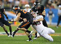 STANFORD, CA - January 2, 2012: Stanford long snapper Andrew Fowler (45) makes a tackle against Oklahoma State at the Fiesta Bowl at University of Phoenix Stadium in Phoenix, AZ. Final score Oklahoma State wins 41-38.