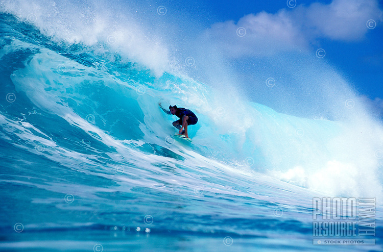 Surfer Eric Totah surfing at Honolua Bay on Maui