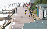 26 SEP 2010 - CLACTON, GBR - Competitors make their way along the promenade during the Clacton Standard Distance Triathlon (PHOTO (C) NIGEL FARROW)