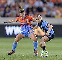 Alyssa Mautz (4) of the Chicago Red Stars and Amber Brooks (12) of the Houston Dash battle for the ball in the first half on Saturday, April 16, 2016 at BBVA Compass Stadium in Houston Texas.