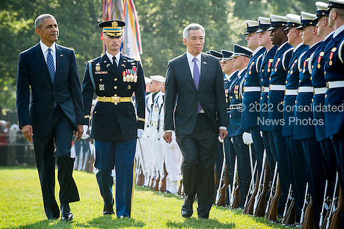 United States President Barack Obama and Prime Minister Lee Hsien Loong of Singapore review the troops during official welcoming ceremonies on the South Lawn of the White House in Washington, DC on August 2, 2016. Lee is on a State Visit to the United States.  <br /> Credit: Pete Marovich / Pool via CNP