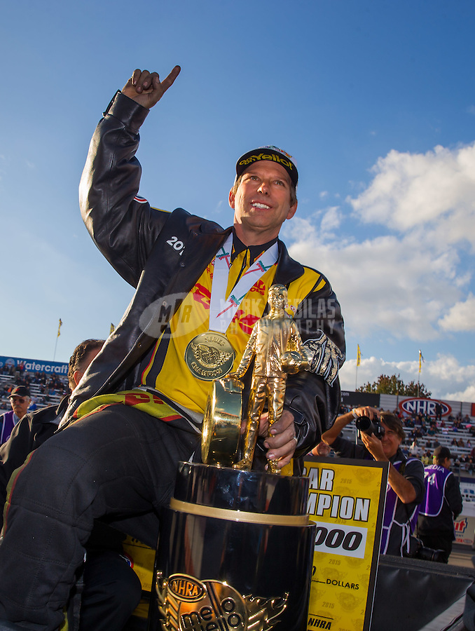 Nov 15, 2015; Pomona, CA, USA; NHRA funny car driver Del Worsham celebrates after clinching the 2015 funny car championship during the Auto Club Finals at Auto Club Raceway at Pomona. Mandatory Credit: Mark J. Rebilas-USA TODAY Sports