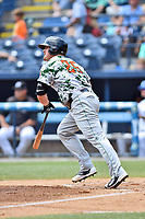Augusta GreenJackets first baseman Skyler Ewing (25) swings at a pitch during a game against the Asheville Tourists at McCormick Field on July 16, 2017 in Asheville, North Carolina. The GreenJackets defeated the Tourists 10-9. (Tony Farlow/Four Seam Images)