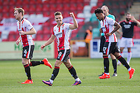Billy Waters of Cheltenham celebrates scoring his side's first goal during the Sky Bet League 2 match between Cheltenham Town and Crawley Town at the LCI Rail Stadium, Cheltenham, England on 15 October 2016. Photo by Mark  Hawkins.