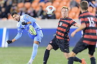 Houston, TX - Friday December 9, 2016: Mauricio Pineda (2) of the North Carolina Tar Heels takes a shot at the Stanford Cardinal goal at the NCAA Men's Soccer Semifinals at BBVA Compass Stadium in Houston Texas.