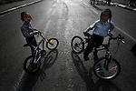 An Ultra-Orthodox Jewish boys are  seen riding bicycles at a rally in Jerusalem. More than 2,000 ultra-Orthodox protestors demonstrated Thursday , demanding that the Egged bus company introduce more segregated buses in the capital. Photo By : Emil Salman / JINI