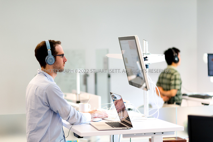 SEATTLE, USA - SEPTEMBER 16th, 2015<br /> <br /> Roie Levin (left), a Software Engineer at the Allen Institute for Artificial Intelligence works at his standing desk at the institute&rsquo;s office in Seattle, WA, USA. <br /> <br /> The Allen Institute for Artificial Intelligence (abbreviated AI2) is a research institute funded by Microsoft co-founder Paul Allen to achieve scientific breakthroughs by constructing AI systems with reasoning, learning and reading capabilities. Oren Etzioni was appointed by Paul Allen in September 2013 to direct the research at the institute.<br /> <br /> (Photo by Stuart Isett for The Washington Post)