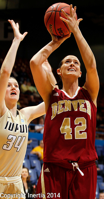 SIOUX FALLS, SD - MARCH 10:  Alison Janecek #42 from Denver shoots a short jumper over Nevena Markovic #34 from IUPUI in the second half of their semifinal game at the 2014 Summit League Basketball Championships Monday at the Sioux Falls Arena(Photo by Dave Eggen/Inertia)