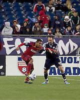 Real Salt Lake forward Paulo Araujo Jr. (23) dribbles as New England Revolution defender Ryan Cochrane (45) defends. In a Major League Soccer (MLS) match, Real Salt Lake defeated the New England Revolution, 2-0, at Gillette Stadium on April 9, 2011.