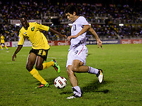 Alejandro Guido (10) of the United States tries to make it past Quante Smith (6) of Jamaica during the semifinals of the CONCACAF Men's Under 17 Championship at Catherine Hall Stadium in Montego Bay, Jamaica. The United States defeated Jamaica, 2-0.