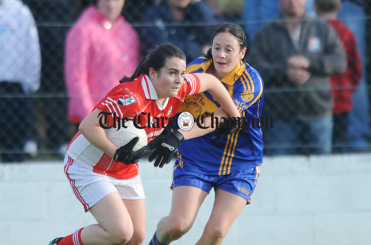 Imelda Kennedy of Shannon Gaels holds off the challenge of Grainne Ryan. Photograph by Declan Monaghan