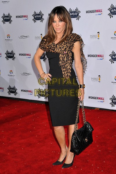 "ROBIN ANTIN .Rally for Kids with Cancer ""The Qualifiers"" Celebrity Draft Party held at the Roosevelt Hotel, Hollywood, CA, USA, 1st May 2009..full length leopard print scarf black dress shoes Chanel bag hand on hip chain strap .CAP/ADM/BP.©Byron Purvis/Admedia/Capital Pictures"