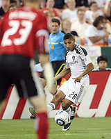 Troy Perkins #23 of D.C. United watches a cross from Sean Franklin #28 of the Los Angeles Galaxy during an MLS match at RFK Stadium on July 18 2010, in Washington D.C. Galaxy won 2-1.
