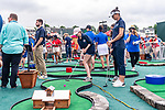 CROMWELL, CT. 19 June 2019-061919 - Emma Thistlewaite of New Hartford, center, hits the ball as Actress Bridget Moynihan from the show Blue Bloods, right, looks on during the Travelers Championship's Dunkin Celebrity Mini Golf Tournament at the TPC River Highlands in Cromwell on Wednesday. Bill Shettle Republican-American