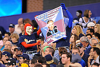 20 December 2011:  FIU's meme generators (wearing Guy Fawkes masks) hold up a sign commenting on the bowl tie-ins in the first half as the Marshall University Thundering Herd defeated the FIU Golden Panthers, 20-10, to win the Beef 'O'Brady's St. Petersburg Bowl at Tropicana Field in St. Petersburg, Florida.
