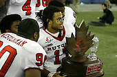 January 5th, 2008:  Rutgers Damaso Munoz (17) and others pose with the championship trophy after the International Bowl at the Rogers Centre in Toronto, Ontario Canada...Rutgers defeated Ball State 52-30.  ..Photo By:  Mike Janes Photography