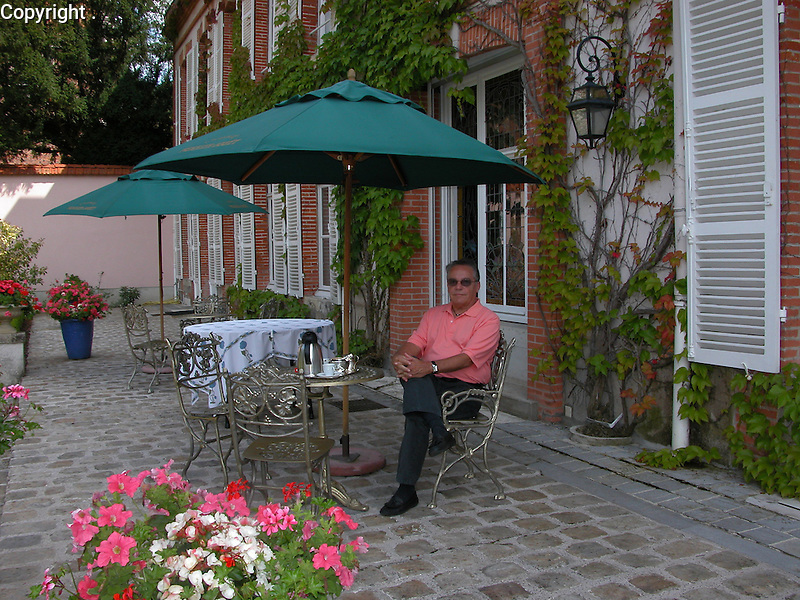 Guy relaxes in the garden of La Maison Belle Epoche, the home of Champagne Perrier Jouet, in Epernay, France.