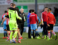 Stevenage's Paul Farman hugs Lincoln City's Matt Rhead at the end of the game<br /> <br /> Photographer Chris Vaughan/CameraSport<br /> <br /> The EFL Sky Bet League Two - Lincoln City v Stevenage - Saturday 16th February 2019 - Sincil Bank - Lincoln<br /> <br /> World Copyright © 2019 CameraSport. All rights reserved. 43 Linden Ave. Countesthorpe. Leicester. England. LE8 5PG - Tel: +44 (0) 116 277 4147 - admin@camerasport.com - www.camerasport.com