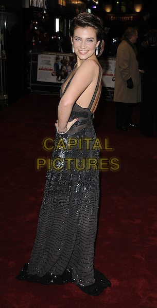 """CAMILLA ARFWEDSON.World Premiere of """"Bunch of Amateurs"""" at the Odeon, Leicester Square London, England..November 17th 2008.full length black halterneck low cut beaded sequined sequins dress silver sheer hand on hip looking over shoulder .CAP/CAN.©Can Nguyen/Capital Pictures."""