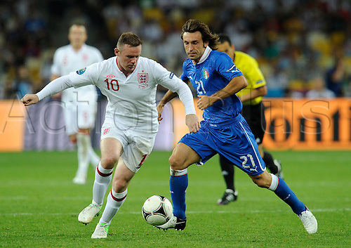 24.06.2012 Kiev, Ukraine. Quarter-Final: England v Italy. Wayne ROONEY (ENG) vs Andrea PIRLO (ITA).
