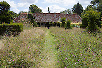 A grass pathway, leading to 'The Hovel' is mown through a wildflower meadow at Great Dixter.
