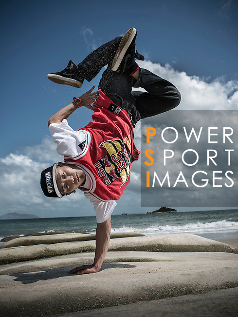 B-Boy Lil Han of Taiwan poses for a portrait at the Lower Cheung Sha beach in the Hong Kong's Lantau island, ahead the Red Bull BC One Cypher on July 01, 2012. Photo by Victor Fraile / The Power of Sport Images