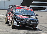 Patrick Moro (59) driver of the PMR Motorsports car, in action during the Global Rally Cross race, the Hoon Kaboom, at Texas Motor Speedway in Fort Worth,Texas. Global Rally Cross driver Marcos Gronholm (3) wins the Hoon Kaboom race..