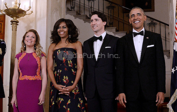 United States President Barack Obama, right, First Lady Michelle Obama, left center, and Prime Minister Justin Trudeau of Canada, right center, and and Mrs. Sophie Gr&Egrave;goire Trudeau, left,  pose for the official photo on the Grand Staircase of the White House March 10, 2016 in Washington,D.C. <br /> Credit: Olivier Douliery / Pool via CNP/MediaPunch