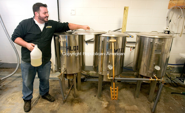WOLCOTT CT. 07 December 2014-010714SV03-Eric Beutel of Shebeen Brewery adjusts the PH while making beer in Wolcott Tuesday.<br /> Steven Valenti Republican-American