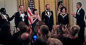 United States President Barack Obama hosts the reception for the  37th Kennedy Center Honorees in the East Room of the White House in Washington, D.C. on Sunday, December 7, 2014.  From left to right: Al Green,  Tom Hanks, Patricia McBride, Sting, Lily Tomlin and President Obama.<br /> Credit: Dennis Brack / Pool via CNP