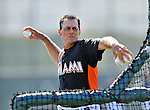 13 March 2012: Miami Marlins Pitching Coach Randy St. Claire serves up batting practice prior to a Spring Training game against the Atlanta Braves at Roger Dean Stadium in Jupiter, Florida. The two teams battled to a 2-2 tie playing 10 innings of Grapefruit League action. Mandatory Credit: Ed Wolfstein Photo
