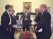United States President George W. Bush meets with Congressional leaders in the Oval Office of the White House in Washington, DC, Tuesday morning, December 18, 2001. (Each received a wrapped White House Christmas ornament from the President, which they are holding.)<br /> From left to right: US Senate Minority Leader Trent Lott (Republican of Mississippi), US Senate Majority Leader Tom Daschle (Democrat of South Dakota), Speaker of the US House of Representatives Dennis Hastert (Republican of Illinois) and US House Minority Leader Richard Gephardt (Democrat of Missouri).<br /> Mandatory Credit: Eric A. Draper / White House via CNP