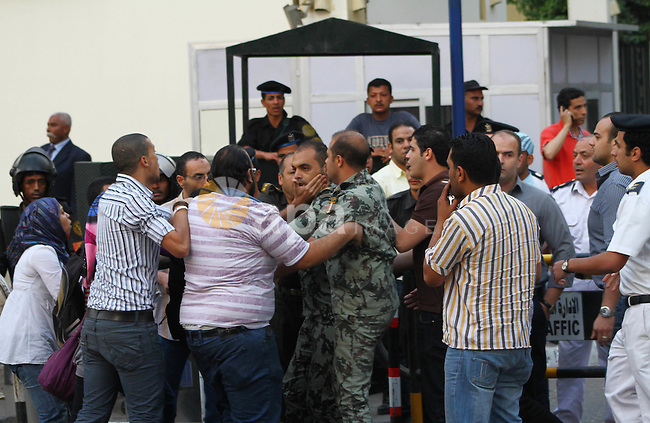 An Egyptian Army officer argues with protesters demonstrating in front of the Saudi Embassy in Cairo, Egypt to demand the release of an Egyptian human rights lawyer detained in Saudi Arabia for allegedly insulting the kingdom's monarch, Saturday, April 28, 2012. Saudi Arabia said Saturday that it has closed embassy in Cairo because of protests over a detained Egyptian. Photo by Ashraf Amra