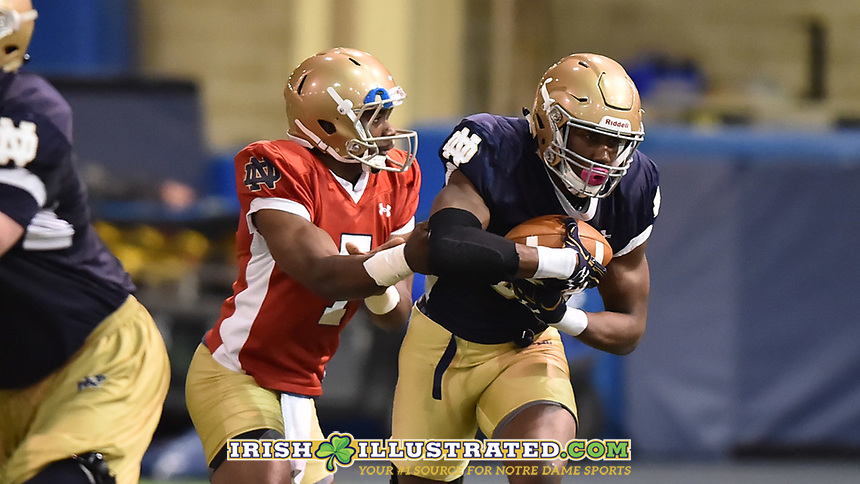 Quarterback Brandon Wimbush (7), running back Josh Adams (33)