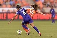 Houston, TX - Friday May 20, 2016: Kristen Edmonds (12) of the Orlando Pride battles with Allysha Chapman (15) of the Houston Dash for the ball The Orlando Pride defeated the Houston Dash 1-0 during a regular season National Women's Soccer League (NWSL) match at BBVA Compass Stadium.